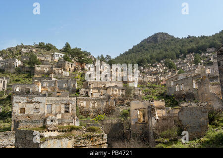 The abandoned hillside village of Kayakoy in Turkey. A left over from the Greco-turkish disagreements. - Stock Photo