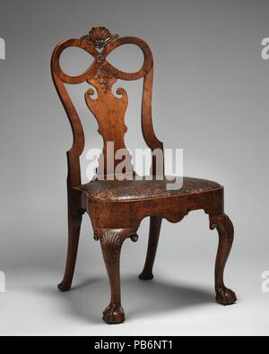 Side chair (one of a pair). Culture: British. Dimensions: Overall: 40 × 20 3/4 × 20 in. (101.6 × 52.7 × 50.8 cm). Date: ca. 1730. Museum: Metropolitan Museum of Art, New York, USA. - Stock Photo