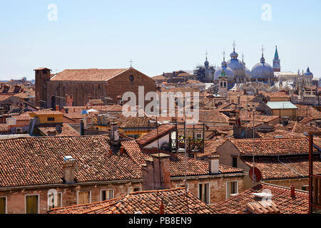 Venice roofs, bricks buildings and San Marco basilica domes in summer, Italy - Stock Photo