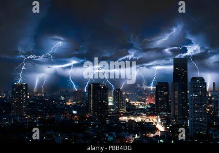 Lightning storm over city in blue light - Stock Photo