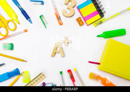 school supplies in the school desk, stationery, school concept, blue background, creative chaos, space for text, markers, pens, notepads, stickers. hi - Stock Photo