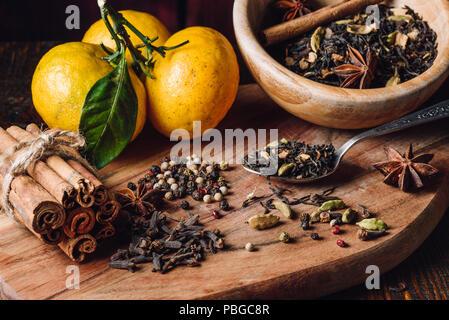 Indian Masala Chai Ingredients with Three Tangerines - Stock Photo
