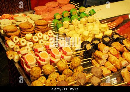 Tray of Brightly Coloured Food on Sticks at Food Market, Phnom Penh, Cambodia - Stock Photo