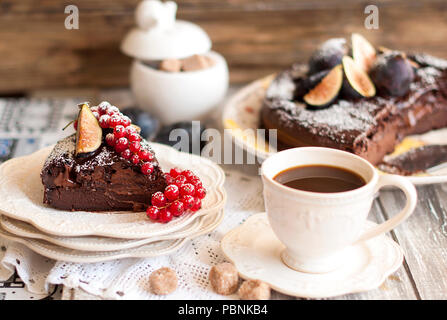 chocolate cake with berries and coffee, decor of red currants and figs. Autumn fruits and pastries for breakfast. - Stock Photo