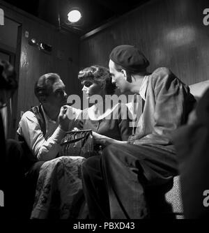 Ingmar Bergman. 1918-2007.  Swedish film director. Pictured here 1949 on the film set of the movie Thirst directing actors Birger Malmsten and Eva Henning in the film. Photographer: Kristoffersson/ap70/2 - Stock Photo