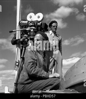Ingmar Bergman. 1918-2007.  Swedish film director. Pictured here 1950 on the film set of the movie Summer Interlude. The film had premiere 1951. Photographer: Kristoffersson/az32/11 - Stock Photo