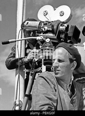 Ingmar Bergman. 1918-2007.  Swedish film director. Pictured here 1950 on the film set of the movie Summer Interlude talking to actor Birger Malmsten. The film had premiere 1951. Photographer: Kristoffersson/AZ32-11 - Stock Photo