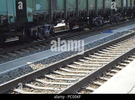 The concept of logistics of transportation of goods by rail, freight train on the rails - Stock Photo