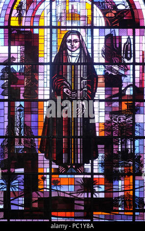 Saint Therese of the Child Jesus, stained glass window in the St Francis Xavier's Church in Paris, France - Stock Photo