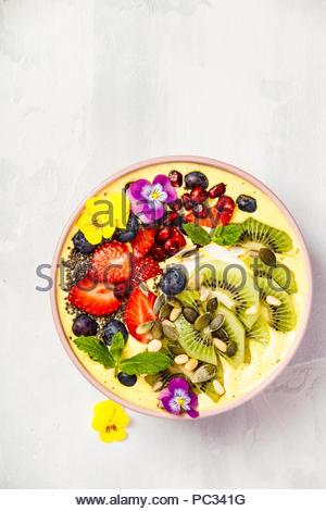 Mango banana pineapple turmeric smoothie bowl - Stock Photo