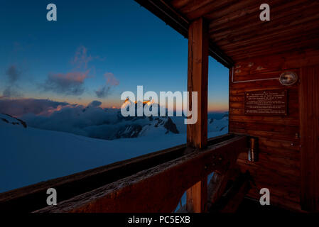 Sunset light in the Valle Blanche, Le Dent du Geant and the Grandes Jorasses fron the Cosmiques hut, Mont Blanc Massif, Haute Savoie, Chamonix, France - Stock Photo