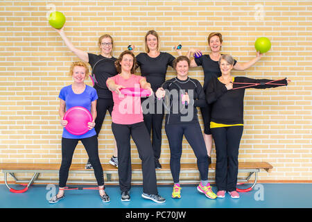 Group photo women gym class with sport equipment in gym - Stock Photo