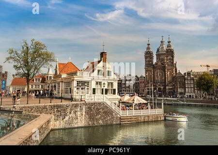 Amsterdam, Netherlands - July 20th, 2018: View of the Canal Cruise  Museum next to Amsterdam Central station. - Stock Photo