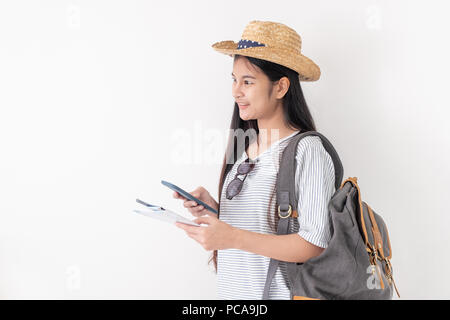 Asian woman traveler backpacker use map and mobile phone app to search for route location of place with gps on white background,Technology in lifestyl - Stock Photo