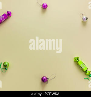 Decorative background yellow Christmas composition Flat lay Christmas tree toys candy balls. Top view, copy space - Stock Photo