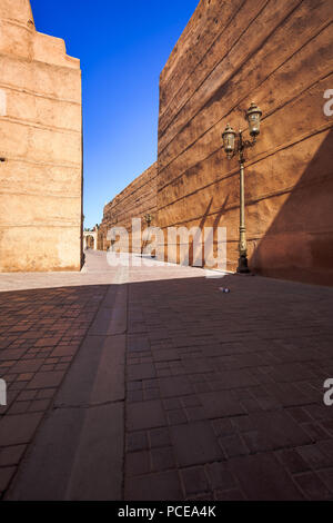 travelling through the colorful streets of Marrakech, between handmade doors and huge gate - Stock Photo