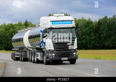 White Scania R730 tank truck for Haanpaa drives along highway on an overcast day of summer to pick up a load. Kaarina, Finland - June 29, 2018. - Stock Photo