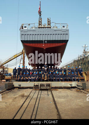 MANAMA, Bahrain (June 17, 2017) The crew of the mine countermeasure ship USS Devastator (MCM 6) stands underneath the ship's hull before it leaves dry dock. Devastator upgraded in several warfare areas including mine warfare, cyber readiness and engineering as well as improvements to the engineering plant, underwater hull, crew living spaces and the installation of the AN/SLQ-60 SeaFox mine neutralization system. - Stock Photo