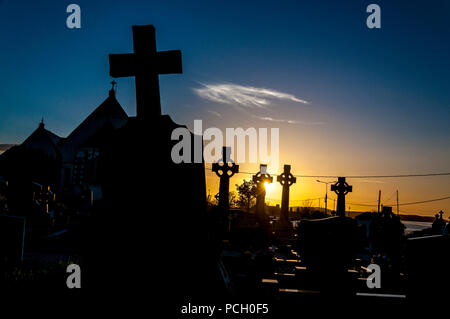 Sunset, cemetery graveyard in Ardara, County Donegal, Ireland. - Stock Photo