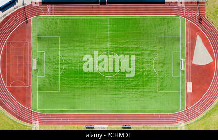 a real new soccer field, football field. Green grass. green striped lawn. White markings on the grass. running track for athletics - Stock Photo
