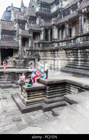 Angkor Wat, Cambodia - 11th January 2018: Chinese tourists pose for photos, Huge numbers visit the temple complae. - Stock Photo