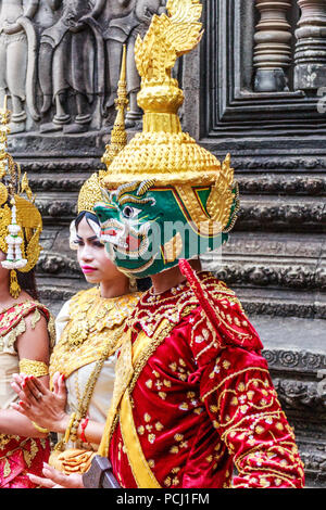 Angkor Wat, Cambodia - 11th January 2018: Dancer in traditional dress and mask. They perform here every day. - Stock Photo