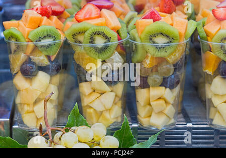 Fruit salad being sold in plastic cups Rome Italy - Stock Photo