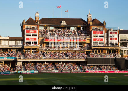 The Micky Stewart Members' Pavilion overlooking 20 20 day night match and the cricket pitch / wicket of The Oval cricket ground (The Kia Oval) Vauxhall, London. UK. (100) - Stock Photo