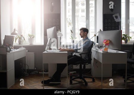 A man working in a modern design office  - Stock Photo