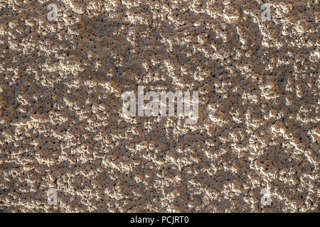 Rough surface of the concrete wall of the house. - Stock Photo