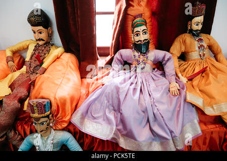 Udaipur, India - December 12, 2017 : Indian traditional dolls at Bagore Ki Haveli - Stock Photo