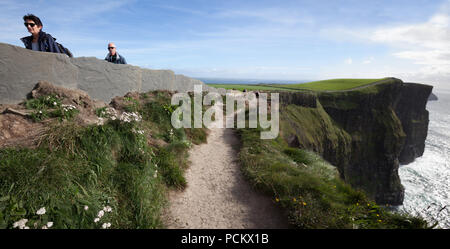 The Burren Way on the Cliffs of Moher Coastal Trail on the Wild Atlantic Way in County Clare, Ireland - Stock Photo