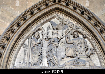 Bass relief on the portal of the Basilica of Saint Clotilde in Paris, France - Stock Photo