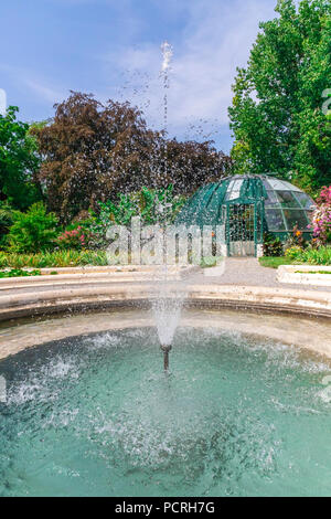 Fountain in a botanical garden in Zagreb on a sunny day - Stock Photo