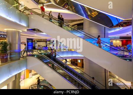 Tourists and locals shopping in a shopping center, escalators, Ion Orchard shopping mall, Orchard Road, Singapore, Asia, Singapore - Stock Photo