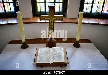 Open Bible in front of Christ Cross, candles, Evangelical St. John's Church, town church, Dusseldorf, North Rhine-Westphalia, Germany - Stock Photo