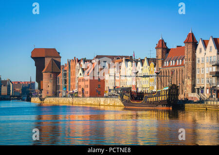 Pomerania Baltic Poland, view at sunrise of the historical Old Town waterfront area in the center of Gdansk, Pomerania, Poland. - Stock Photo