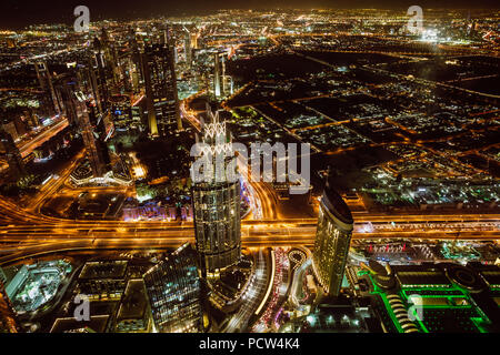 Aerial view of downtown Dubai and skyscrapers at night from the top of Burj Khalifa - Stock Photo