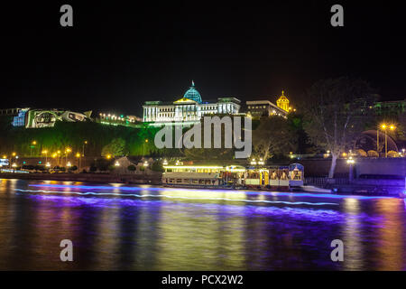 Georgia, Tbilisi night . View from the right bank of the Kura River to the Presidential Palace. - Stock Photo