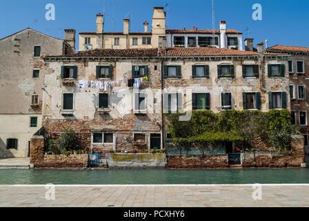 VENICE, ITALY, SEPTEMBER 16, 2008: Traditional venetian house on canal. - Stock Photo