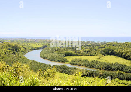 View of the Wailua River, the island's longest and largest, with the ocean in the background on the island of Kauai, Hawaii, United States. - Stock Photo
