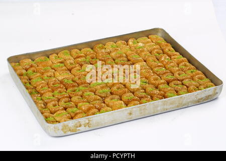 Delicious turkish dessert sekerpare with coconut powder - Stock Photo