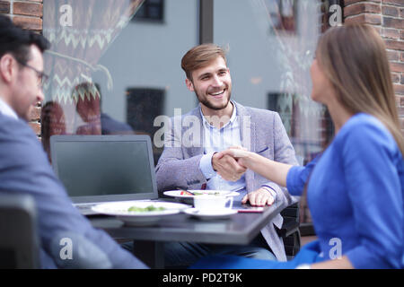 business woman and businessman shaking hands - Stock Photo
