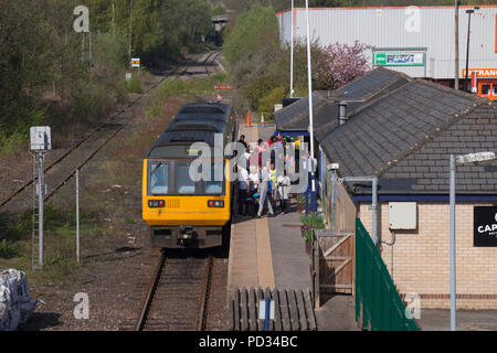 Northern Rail train passengers boarding a class 142 pacer train at Bishop Auckland railway station - Stock Photo