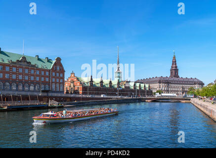 River cruise on Slotsholmens canal looking towards the Børsen (Stock Exchange) and Christiansborg Slot (Christiansborg Palace), Copenhagen, Denmark - Stock Photo