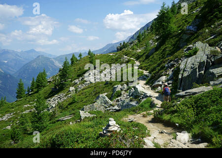 Hiker on trail from Aiguille du Midi to Montanevers, Mont Blanc mountains,, Chamonis, French alps, France - Stock Photo