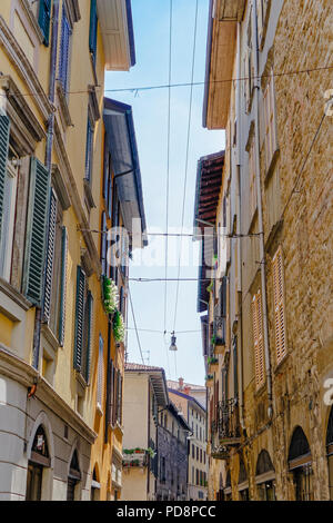 Bergamo, Italy Old Town Traditional houses. Citta Alta historical buildings with decorated iron balconies and flowers. - Stock Photo