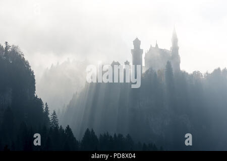 Castle Neuschwanstein in ghostly light - Stock Photo