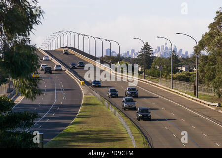 The Captain Cook Bridge at Taren Point, Sydney with a view of the Sydney CBD visible in the distance - Stock Photo