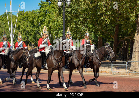 London England August 05, 2018 A detachment of soldiers of The Lifeguards regiment of the Household Cavalry rides along the Mall outside Buckingham Pa - Stock Photo